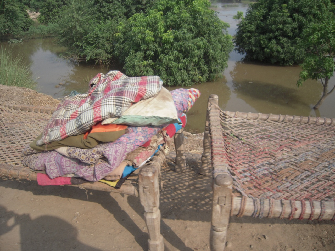 Charpai (wooden frame bed) on the embankment